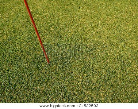 Flag pole in grass sports field