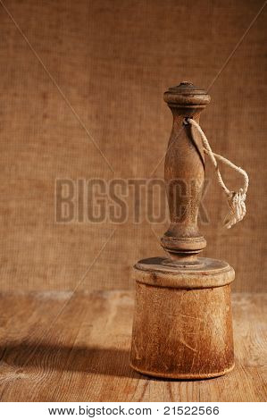 retro potato masher on old wooden table in rustic style