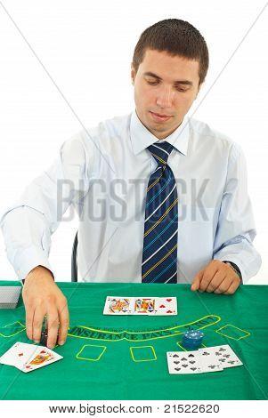 Man Playing Blackjack At Casino