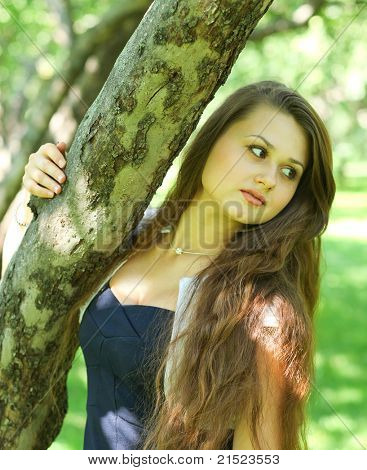 abstract portrait of beautiful young woman relaxing in summer park