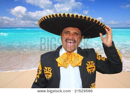 Charro mariachi man portrait shouting in Mexico Caribbean beach