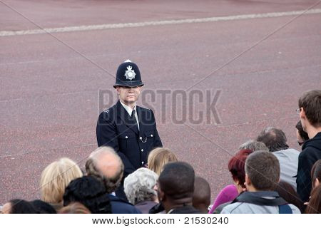 LONDON - JUNE 11: British police observe crowd of spectators during Trooping the Color ceremony, London, June 11, 2011. Ceremony is performed by regiments on occasion of the Queen's Official Birthday