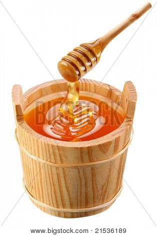 Piggin of honey and wooden stick.