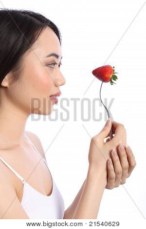 Pretty Chinese Teenager Girl And Strawberry Fruit
