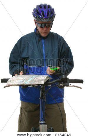 Mtb Rider Reading A Map.