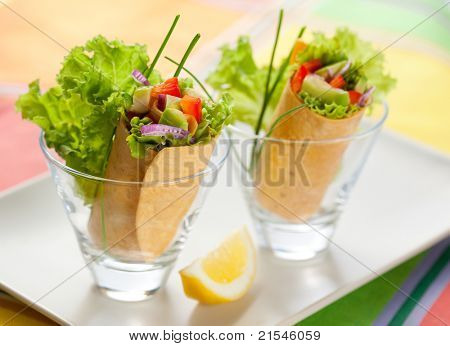 fresh  tortilla wraps with vegetables in glasses