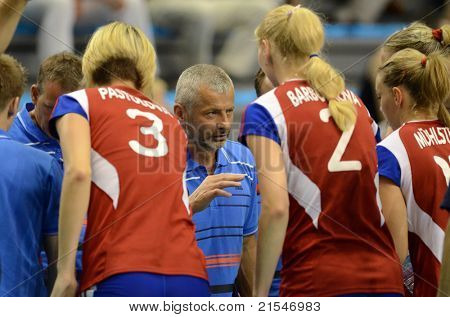 BUDAPEST, HUNGARY - JUNE 18: Jiri Siller (bulgarian teams trainer) (c) in action at a CEV European League woman's volleyball game Hungary vs Czech Republic on June 18, 2011 in Budapest, Hungary.