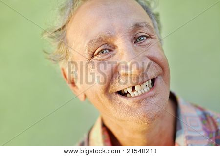 Aged Toothless Man Smiling At Camera