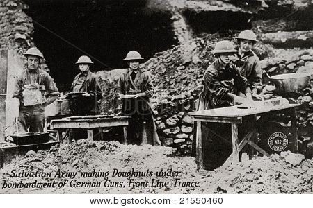 FRANCE - CIRCA 1914-1918: Salvation Army making Donuts - postcard depicting Salvation Army making donuts under bombardment of German guns while in front line in France during WWI, circa 1914-1918.