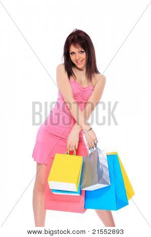 Trendy young girl with shopping bags on white background