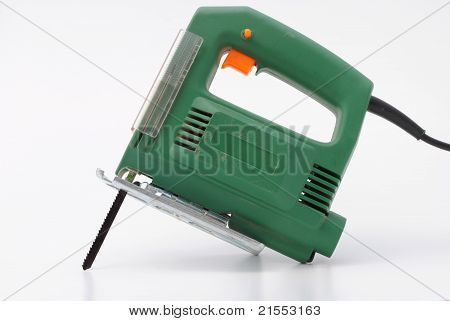 green hacksaw isolated in white background