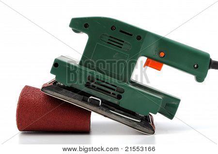 green wood sander with sandpaper roll
