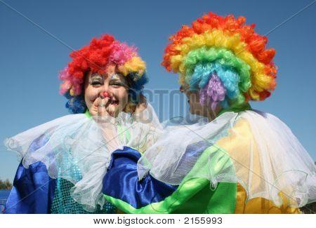 Two Bizzare Clowns In Colored Wigs