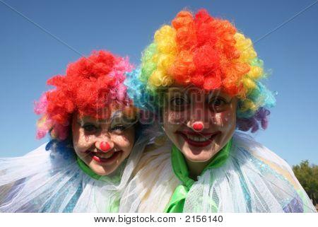 Two Bizzare Clowns In Colored Wigs 4