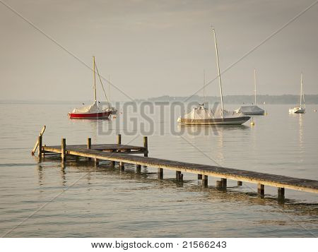 An image of some boats in the early morning mood