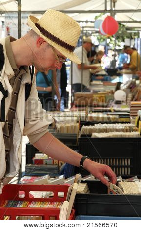 Man Looking At Second Hand Books On A Stall