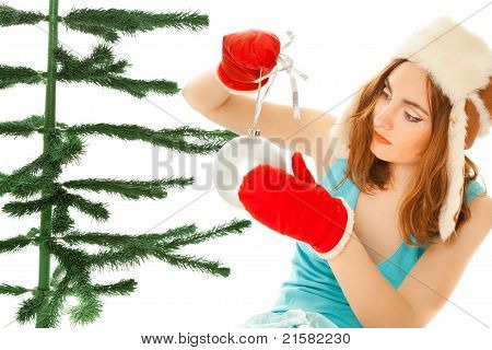 Woman's Hands Dressing Christmas Tree