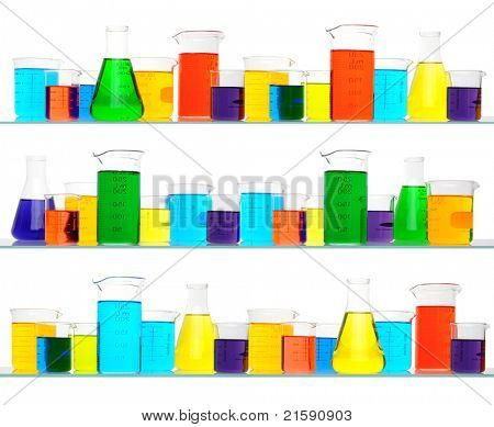 Assorted sizes and shapes of laboratory glassware on three shelves. Beakers are filled with liquids of assorted colors. Square Format isolated on white background.