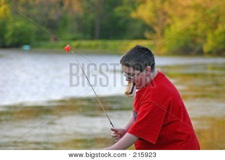 Boy Eating Hotdog While Fishing