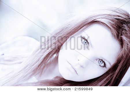 Portrait Of Beautiful Young Girl In High Key