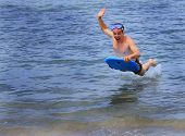 picture of boogie board  - A man flies through the air on his boogie board - JPG
