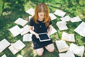 Woman Learning With Ebook Reader And Book. Choice Between Modern Educational Technology And Traditio poster