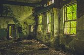 Abandoned Interior In Ruins Of Military Settlement. poster