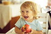 Laughing Baby Boy With Apple poster