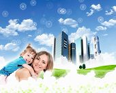 stock photo of dream home  - happy family spends time together on nature  - JPG