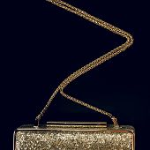 Festive Evening Golden Clutch On Black. Holiday And Celebration Background. Luxury Accessories And P poster