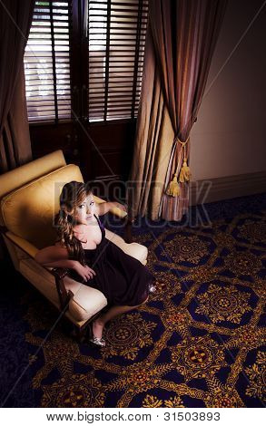 Rich Wealthy Woman Sitting In Upmarket Hotel