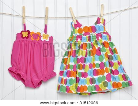 Baby Dress And Bathing Suit On A Clothesline