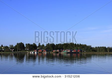 Several small and red boathouses.
