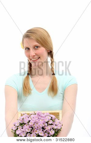 Smiling Blond Female Holding Flowers
