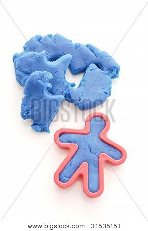 Person Cut Out In Blue Molding Dough