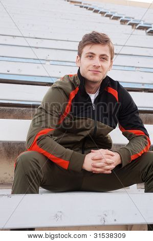Male Athlete Sitting In The Bleachers