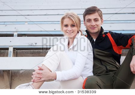 Male And Female Athletes Sitting In The Bleachers
