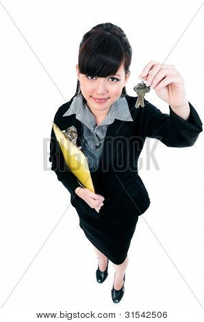 Young Businesswoman Holding Keys