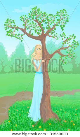 Beautiful Young Woman Beside Tree