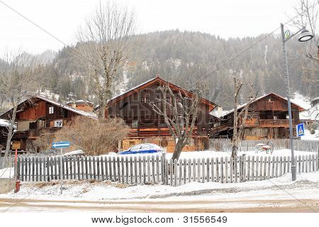 Three Ancient Wooden Houses In Canazei