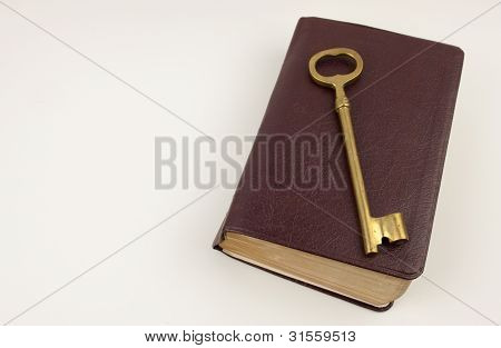Golden Key On A Leather Book Cover