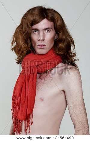 Man With A Naked Torso In A Red Scarf