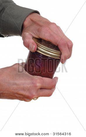 Hands Opening A Jar