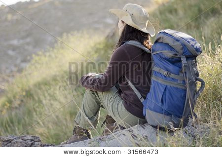 Young woman contemplating the view on a hiking trip