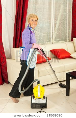 Senior Housewife Cleaning House
