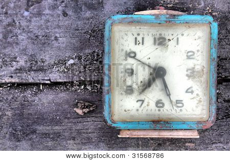 Old Alarm On Wooden Board