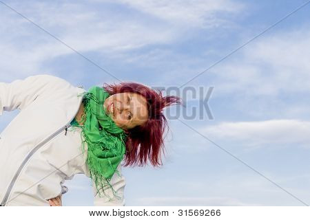Happy smilling woman exercising outdoor