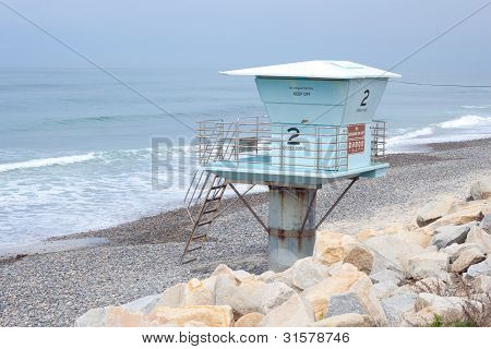 Lonely Lifeguard Tower On Beach