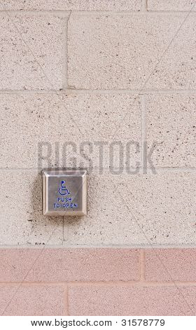 Push To Open Button On Brick Wall