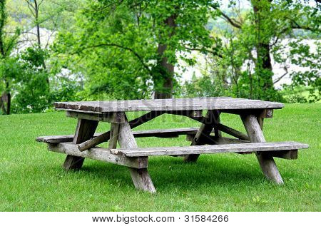 Empty picnic table in park setting